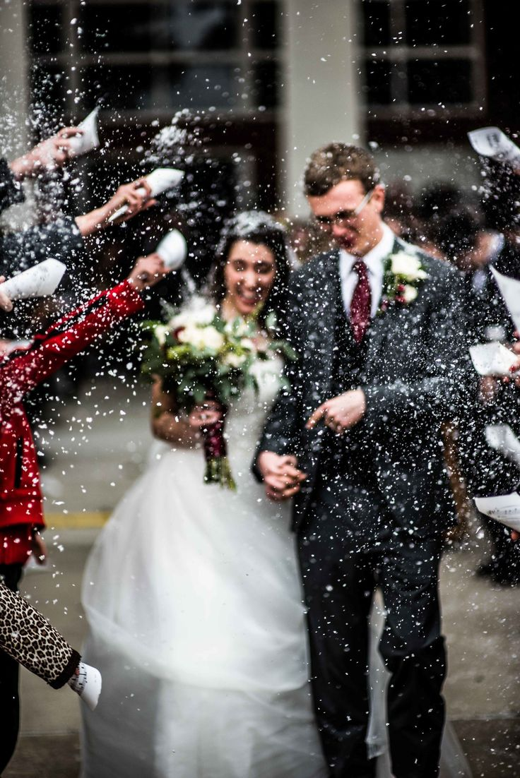 The guests threw fake snow during the wedding exit