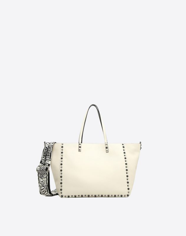 Are you looking for Valentino Garavani Guitar Rockstud Rolling Double Tote? Find out all the details at Valentino Online Boutique and shop designer icons to wear.