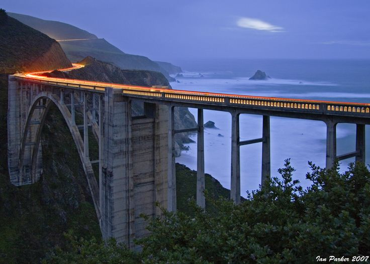 Bixby Bridge, Pacific Coast Highway  The Bixby Bridge, completed in 1932, is a marvel of engineering and one of the top ten highest single span bridges in the world. The bridge spans across a large canyon along the Big Sur Coastline, about 18 miles south of Carmel.