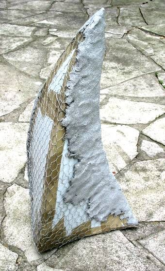 layers being built up over mesh, over plastic form