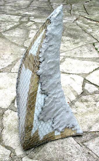 Concrete and hypertufa. Sculpt it over wire.