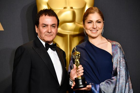 Former NASA scientist Firouz Naderi (left) and engineer/astronaut Anousheh Ansari pose with the Best Foreign Language Film award for 'The Salesman' on behalf of director Asghar Farhadi in the press room during the 89th Annual Academy Awards at Hollywood & Highland Center on Feb. 26, 2017 in Hollywood, California.