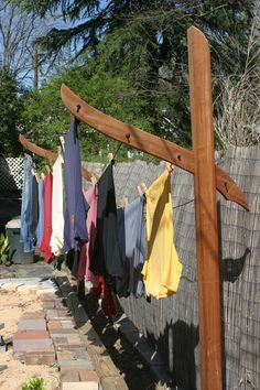"""Clothesline """"Sculpture"""" - I can envision putting this at the end of the deck. For evening outdoor gatherings when not in use, put up strings of lights and food/drink table underneath. Or a nice canopy with climbing roses, clematis or other vine flowers....it would smell divine under it!"""