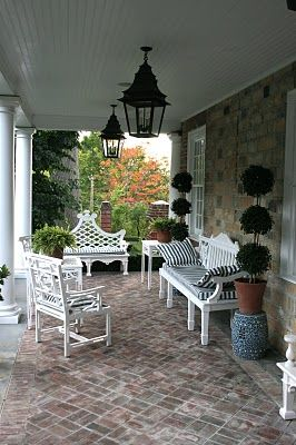 """A view of the """"porch"""" at Carolyne Roehm's country home, """"Weatherstone"""" located in Sharon, Connecticut."""