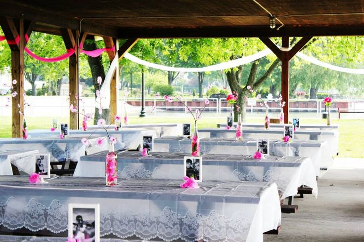 Picnic tables decorated before place settings were added for Amusement park decoration ideas