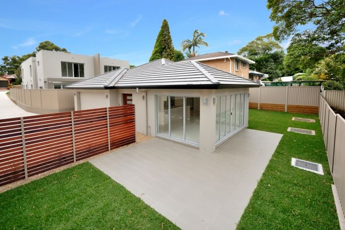 A custom built Trevelle Home and backyard.