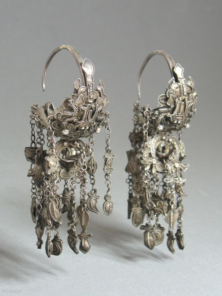 Antique Miao Chinese Silver Earrings- Very 'charming'... Each earring comprises three separate parts, each with several charms hanging from chains, one of which is a bird. For more photos please write us.