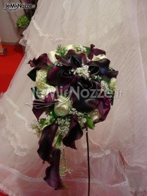 http://www.lemienozze.it/gallerie/foto-fiori-e-allestimenti-matrimonio/img21471.html  Allestimento elegante con fiori per il matrimonio sulle tonalità del viola