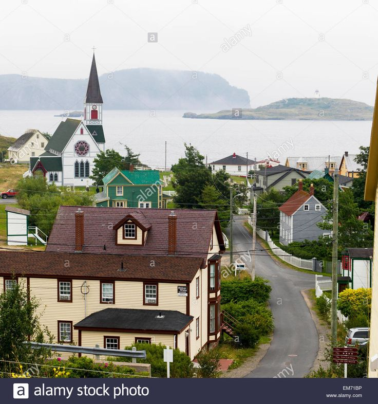 Houses and a church in a quaint atlantic coast town; Trinity, Newfoundland and Labrador, Canada Stock Photo