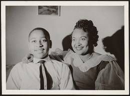 Emmett Till and his mother before his tragic death - The Emmett Till story.