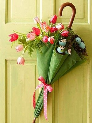 Take a pastel colored umbrella, tie it in the middle to ensure that materials don't fall down and fill it with some silk florals and decorative accents.  Then, hang it on your front door in time for Spring for your guests to enjoy!