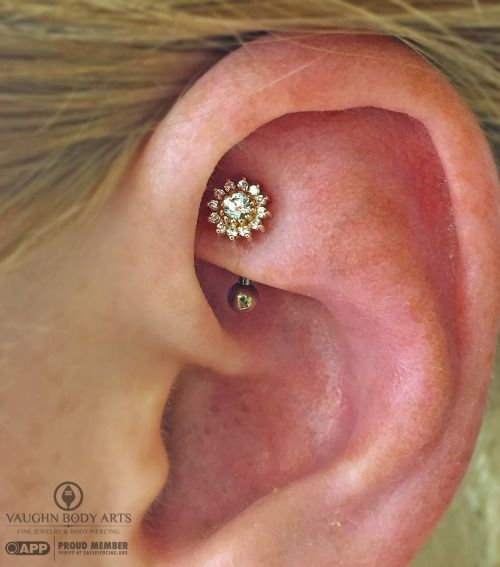 Rook piercing done by Cody Vaughn of Vaughn Body Arts. Jewelry by BVLA.