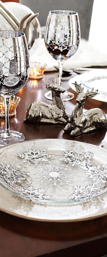 Snowflakes could be places on a silver charger under a clear glass plate.