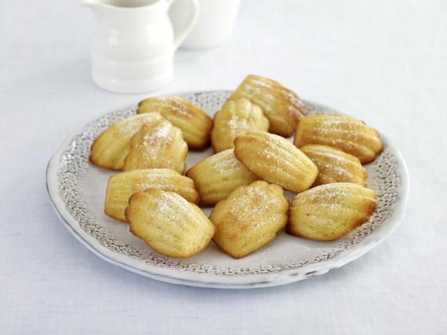 This madeleines recipe features a rich butter, egg, and vanilla batter. Classic madeleine cakes.
