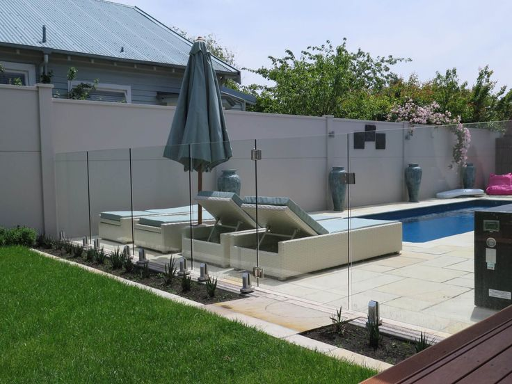 An Outdoor area to Envy!  The seamless finsih of the Glass pool fencing with our EliteWall makes this a backyard i would want to spend my summer in!  #pool #summer #poolfencing #wemakeiteasy  For more inspiration check out: https://www.boundaryline.co.nz/case_study/