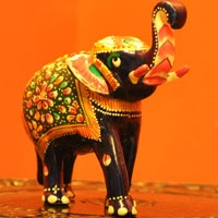 Meenakari Art on Brass Ambavari Elephant- Beautiful Figurines with Fine Meenakari work on Brass Metal.These prints are made by skillful artists, known as 'meenakar'. It is a traditional art of Rajasthan. This beautiful art is believed to be introduced by Mughals in the 16th century and Maharaja Man Singh I of Ambar in the late 17th century.