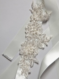 Skylark belt    Embroidered ivory flowers glisten with the silver beaded detailing. Evoking the ornate beauty of the Victorian era.