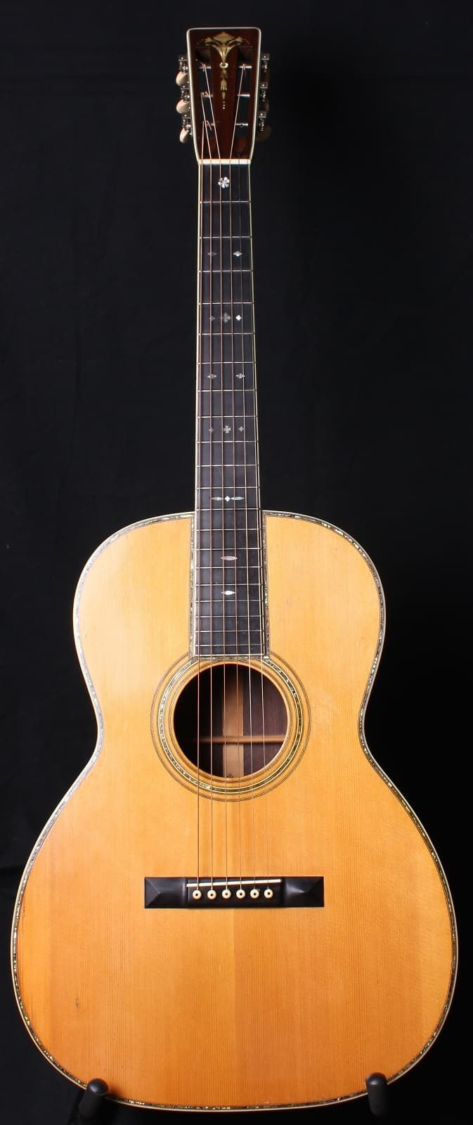 Up for sale today is a crazy rare and highly collectable 1928 Martin 000-45. This guitar features an Adirondack Spruce top, Brazilian Rosewood back and sides, torch headstock inlay and pearl around every nook and cranny you can see. The guitar is in very good, all original condition with the ex...