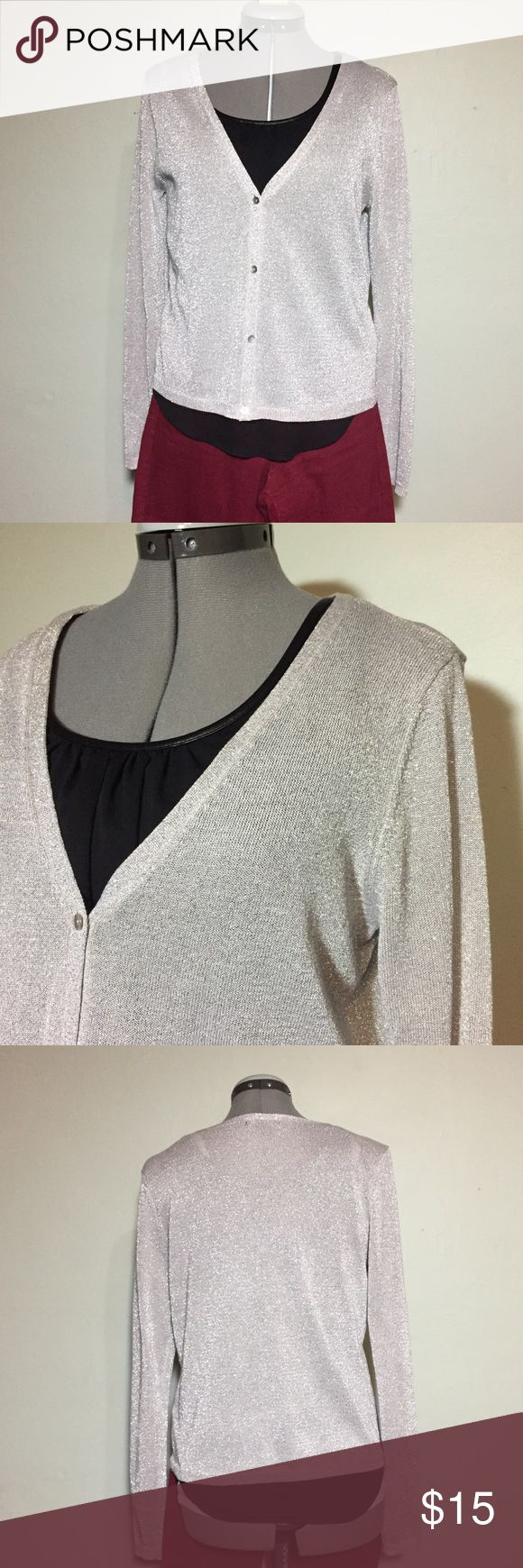 """H&M Light Gray Silver Cardigan - Holiday Ready L H&M Light Gray Silver Cardigan Sweater. The silver metallic woven throughout would look great with a holiday outfit. Size L measures flat: 16"""" across shoulders, 19"""" across chest, 21"""" ladies no, 25"""" sleeve. 61% viscose, 25% poly, 14% metallic. 1120/50/112817 H&M Sweaters Cardigans"""