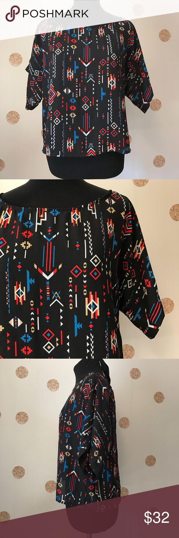 "Cantata Aztec Blouse Great shape - 9/10 condition. Not much stretch. Black. I can't read the tag so unsure of details. Soft flowy material.   Appx measurements taken by me while item is laying flat :  Underarm to underarm - 20"" Shoulder to hem - 20"" Underarm to end of sleeve - 5.5""  Please don't hesitate to ask questions Cantata Tops"