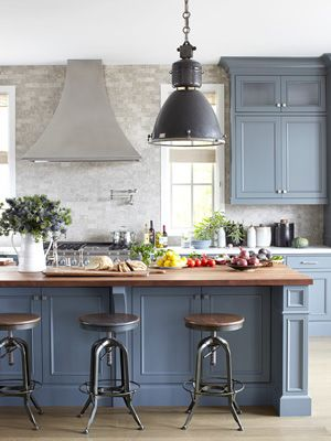 Blue kitchen cabinets painted Benjamin Moore Down Pipe with marble countertops, blue