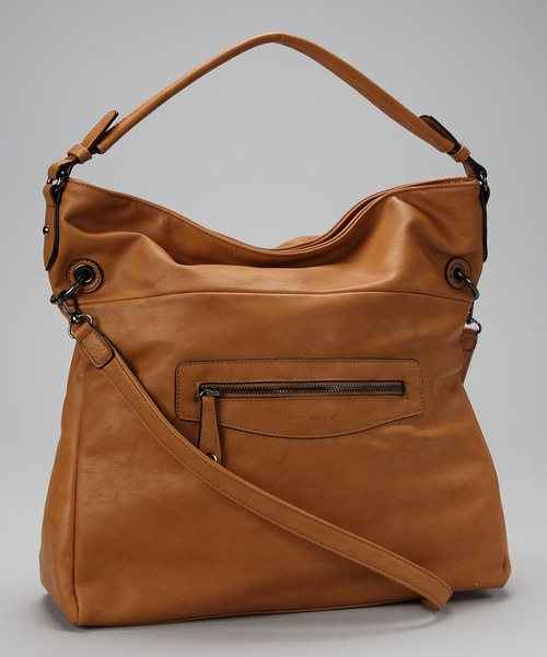 With this chic shoulder bag in tow, the city streets feel like a high-fashion runway. With a faux leather exterior, an exterior zippered pocket and a roomy interior, it makes a glamorous go-to handbag.14.5'' W x 15.25'' H x 5'' DPolyurethaneImported