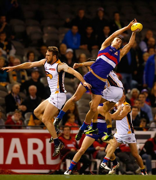 Liam Jones of the Bulldogs attempts a high mark over Eric Mackenzie of the Eagles during the 2013 AFL Round 18 match between the Western Bulldogs and the West Coast Eagles