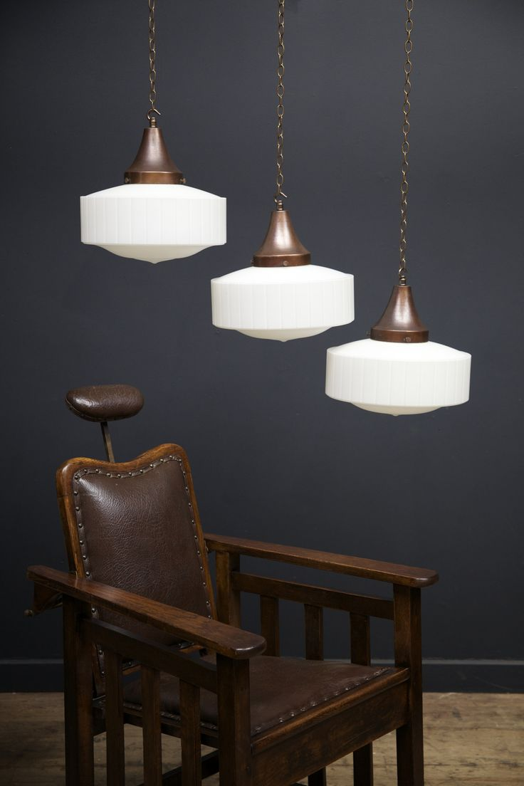 Opaline glass pendant light with flat ribbed sides, above dining table
