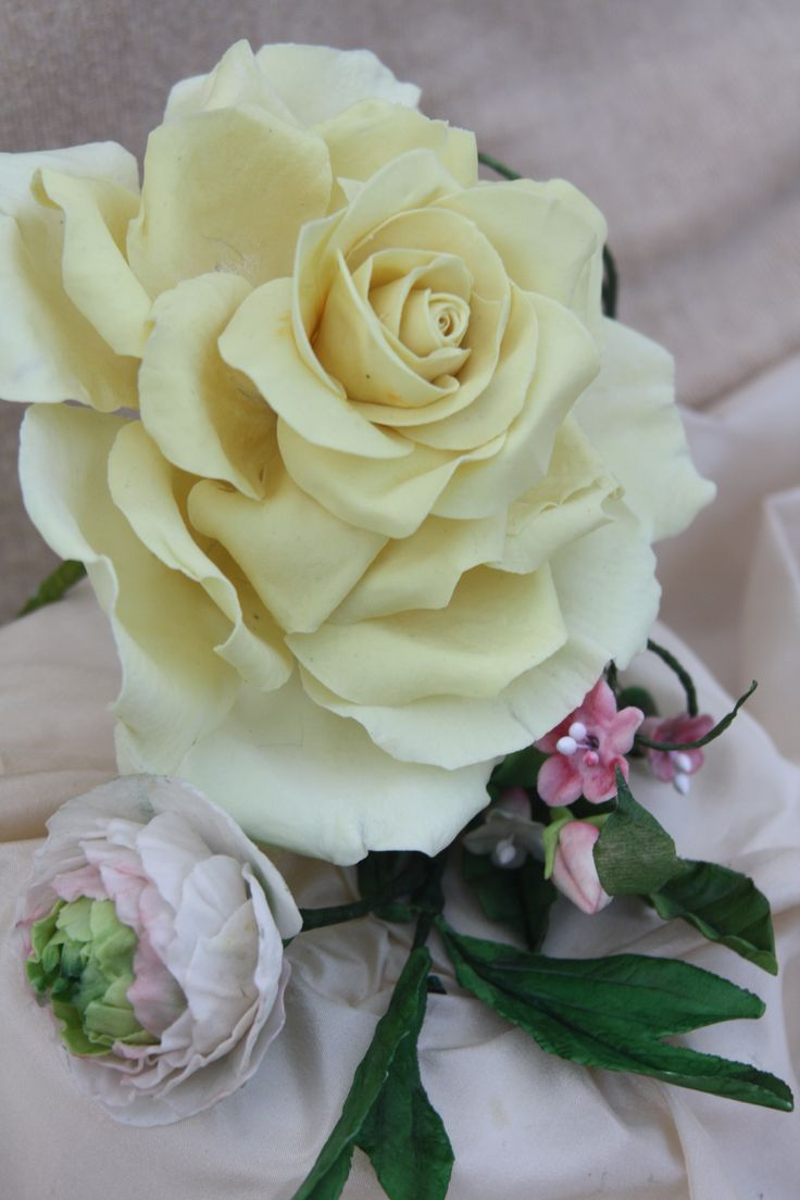 yellow rose and ranuncolo with flower paste