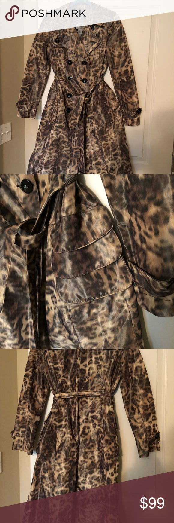 L.A.M.B. Leopard Print Trench Coast 08 Purchased this beautiful trench coat by LAMB at Nordstrom. Worn a few times but is in excellent condition given how long ago it was bought. all buttons are intact, no obvious signs of wear/tear. It is nylon, with a sheen. Please contact with questions! L.A.M.B. Jackets & Coats Trench Coats