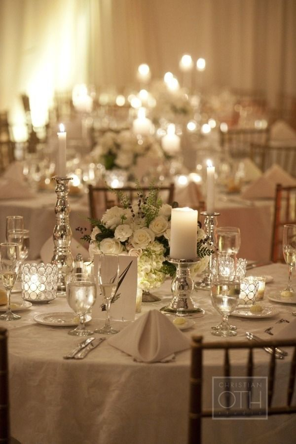 candle light and white flowers with white