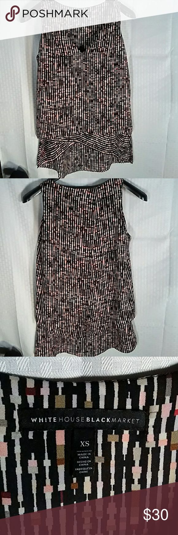 WHBM career top. Black. Sz. XS Beautiful flowy top. Sleeveless. Black background with peach, cream and brown print. Versitile piece for work or dinner with the girls. Multi-layered. 100% polyester. 28 inches shoulder to hem so wearing as a tunic with leggings may work. 18 inches across bust. White House Black Market Tops Blouses