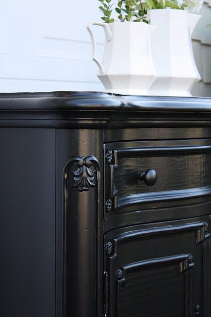 Martha Stewarts 'Silhouette' black paint .... great to refinish a piece & then distress the edges..