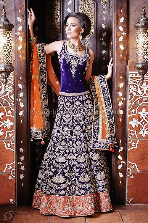 Reception Dresses - Purple velvet lengha ideal for a wedding reception, clustered in Swarovski diamante embroidery with a contrast orange soft net dupatta