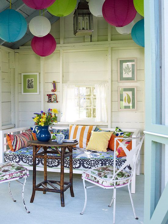 Vibrant paper lanterns and a mixture of patterns add an unexpected splash of color to this space. More outdoor furniture and fabric ideas: http://www.bhg.com/home-improvement/porch/outdoor-rooms/outdoor-furniture-and-fabric-ideas/?socsrc=bhgpin052113paperlanternpatio=10