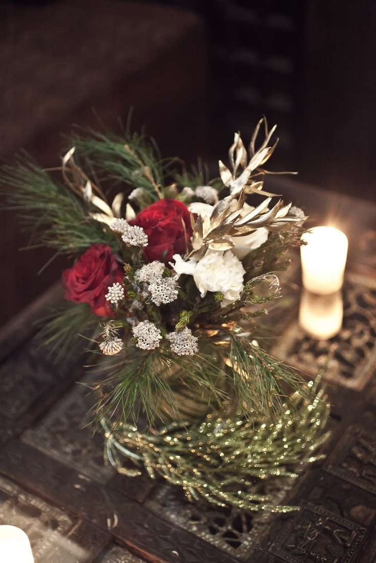 A corporate christmas party with floral arrangements