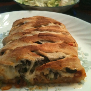 I made a calzone tonight and it was a hit!  I used Pillsbury Pizza Crust Classic, Ragu's Pizza Quick Traditional sauce, grounded garlic chips, canned mushroom pieces, sliced olives, diced pepperoni, fresh onion and green peppers diced and Mozzarella Veggie Shreds. I followed the directions for the pizza crust for oven temp and time. I served the calzone with a salad!  Was an awesome meal!