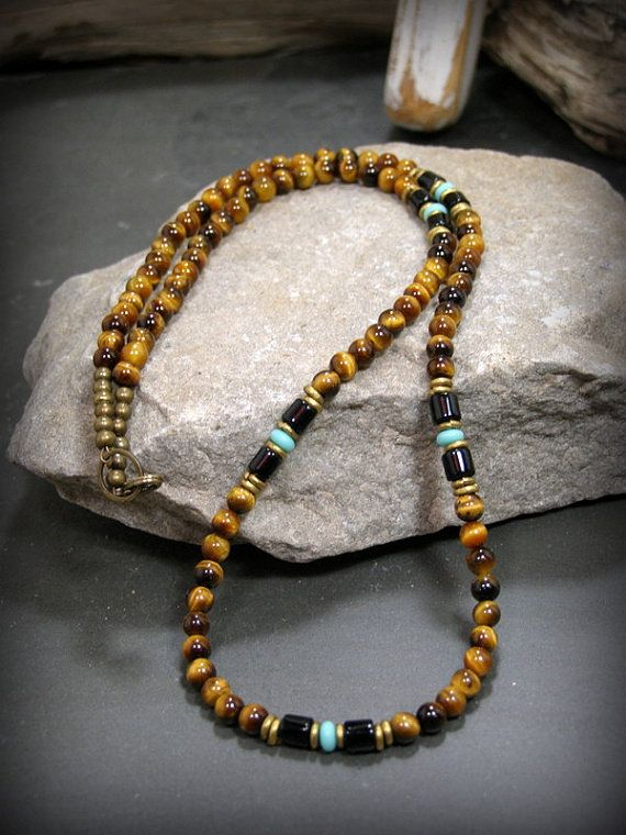 Mens fashion necklace beaded in 4mm tiger eye beads with black tube beads and turquoise czech glass rondelles. Smaller beads for a minimalist style necklace in a choice on lengths. Gorgeous southwest native style necklace finished off with a brass lobster clasp. Length: Choose the length you need from the drop down menu (the necklace pictured is 21 long). ***This will be a custom order made to the size you choose, so please make sure of your purchase as I can not offer refunds on custom…