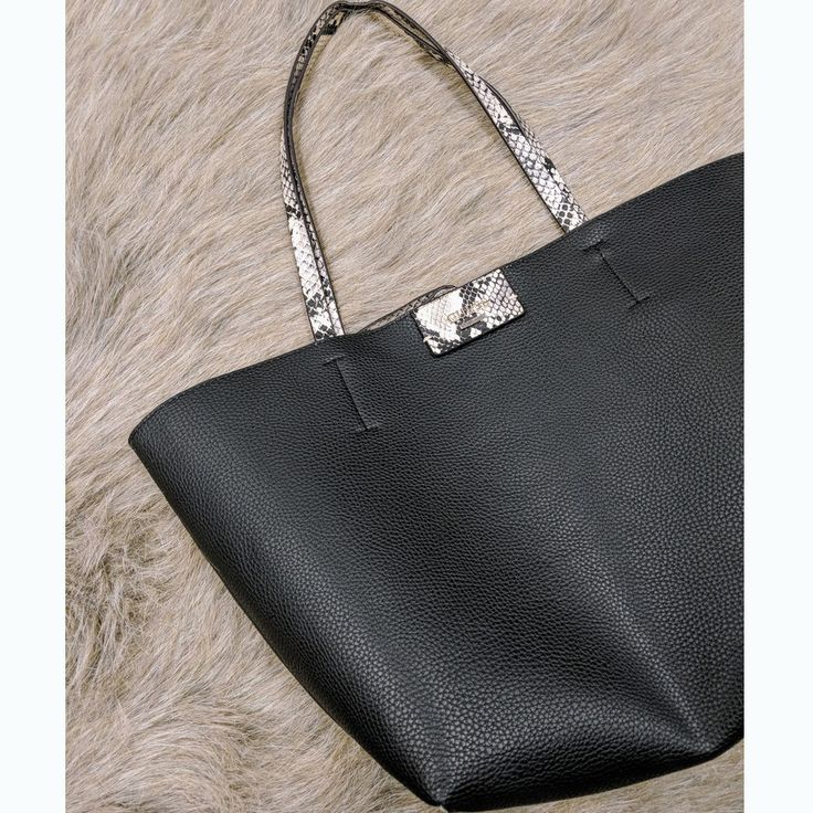You've got one shot, one opportunity...do not miss your chance to own this reversible tote that will make any outfit extra! #PlatosClosetOshawa #gentlyused #funwithlyrics #purseaddiction #totesadorbs // Reversible #Guess tote, $30 // | www.platosclosetoshawa.com