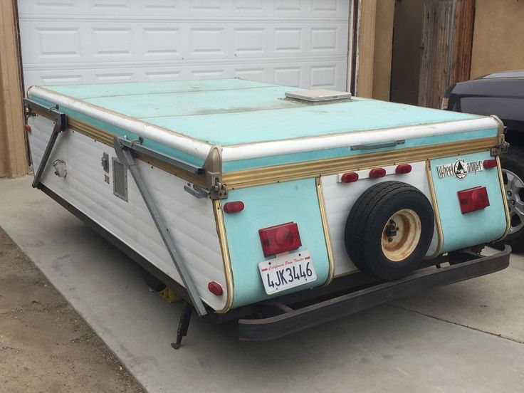 "​Vintage 1970 Wheel Camper tent trailer, second owners. Overall length 13'10"".  Overall length for living 18'. Overall width 6'6"". Weight 980 lbs. Have original brochure and yellow and black..."