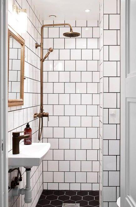 brass bathroom fixtures - Swedish bath with white tile, black ground and bronze-tone fixtures - decordots via atticmag