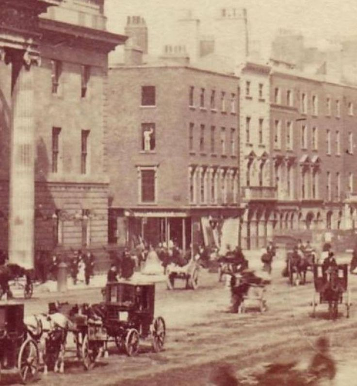 1860's look at the chap cleaning windows on the building at the start of Henry st, no health and safety them days