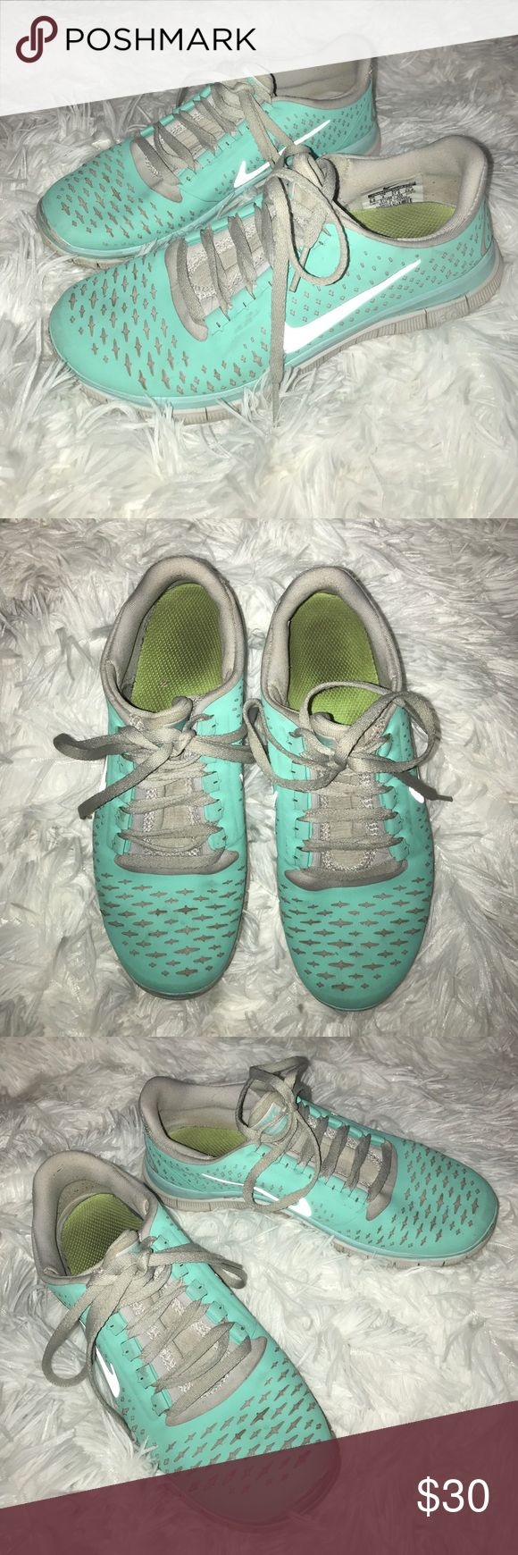 Nike Tiffany blue sneakers 6.5 Definitely got some use out of them, but still have lots of life left! Could probably be cleaned up if tried, but they're sneakers so I've never worried about it. The swoosh is silver, but turns white with flash. Nike Shoes Athletic Shoes