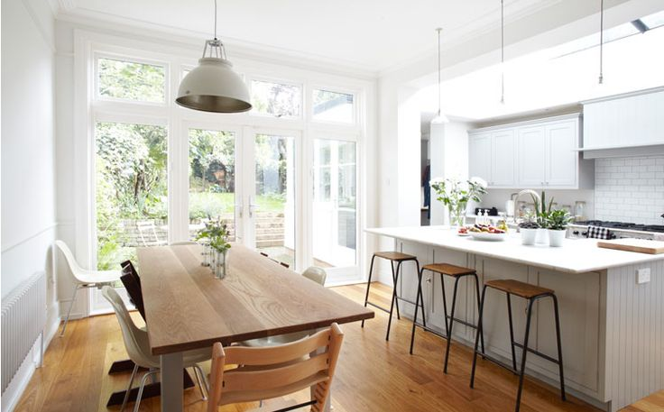 Love the industrial pendant, raw wood table, bar stools, and Stokke chairs! A Light Locations property
