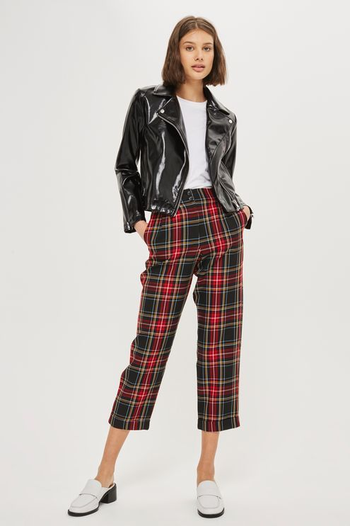 Relaxed silhouette tartan check trousers with a high waist and turn up a the hem.