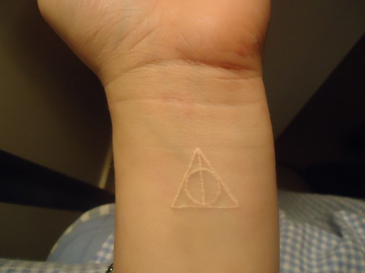 Deathly Hallows white ink tattoo. PERFECT!!!!!!!!!!!!!!!!!!!!!!!!!