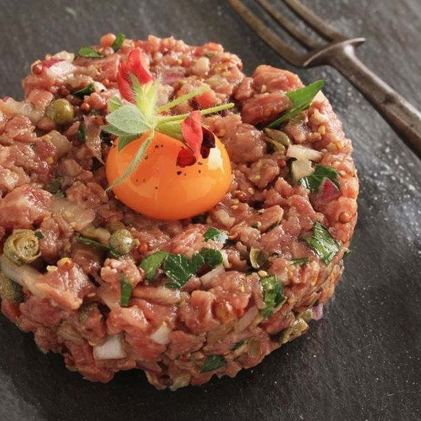 A classic French pairing - tartare with chopped cornichons!