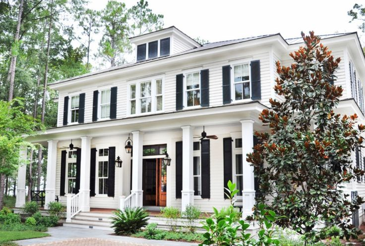 American Colonial Exterior: Columns across front of house, Shutters, symmetrical layout