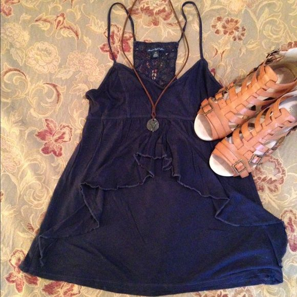 Cami top American Eagle navy blue cami top. Ruffles in front, lace back, adjustable straps. Necklace & shoes not included. Worn but in good condition! American Eagle Outfitters Tops Camisoles