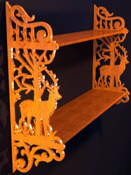 wall shelf with deers and fretwork ornamentation